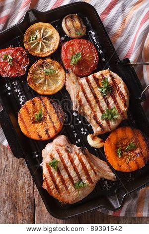 Grilled Pork And Pumpkin On A Grill Pan. Vertical Top View Closeup