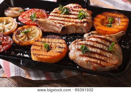 Grilled Pork, Pumpkin And Lemon On A Grill Pan. Horizontal