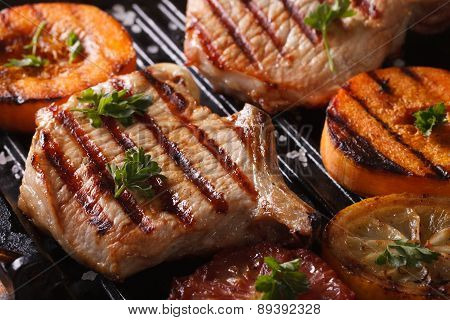 Grilled Pork Steak And Pumpkin On A Grill. Horizontal Macro