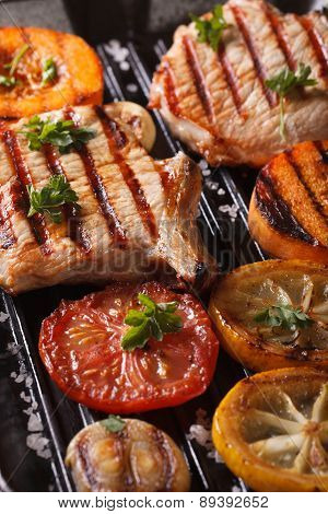 Grilled Pork And Pumpkin On A Grill. Top View Vertical Macro
