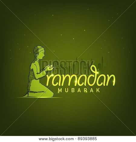 Holy month of Muslim community Ramadan Kareem celebration with a Muslim boy praying (reading Namaz, Islamic Prayer) on green Mosque silhouette background.