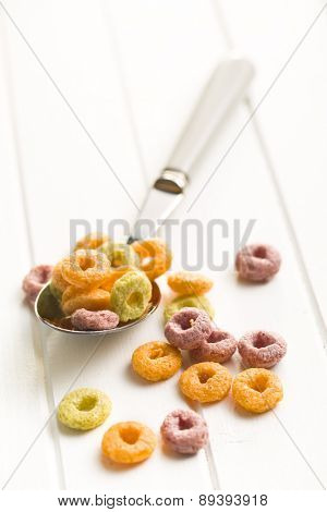 the colorful cereal rings in spoon
