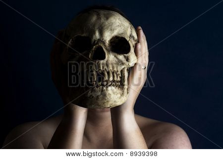Person Holding Skull In Front Of Face