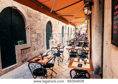 Restaurant terrace in the old town of Dubrovnik in the narrow streets are ready for tourists