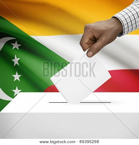 Ballot Box With National Flag On Background - Comoros