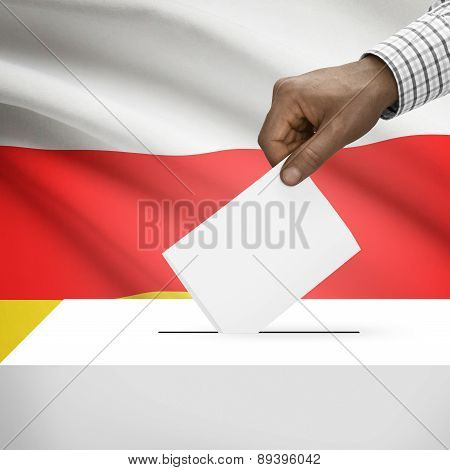 Ballot Box With National Flag On Background - Republic Of South Ossetia
