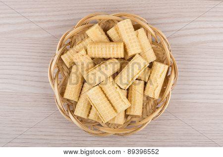 Heap Of Wafer Rolls In Wicker Basket