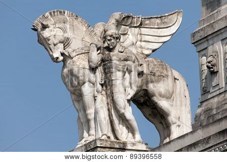 Statue Of A Man Holding A Winged Horse On The Milan's Main Railway Station's Facade