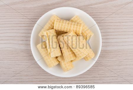 Heap Of Wafer Rolls In Saucer On Table