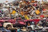 foto of scrap-iron  - old cars were scrapped in a trash compactor - JPG