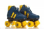 stock photo of roller-skating  - Vintage Retro Blue and Yellow Quad Roller Skates on White Background with Reflection - JPG