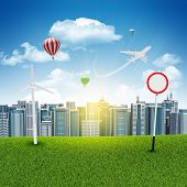 stock photo of wind-power  - Cityscape under blue sky with wind power station and jet - JPG
