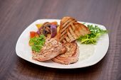 picture of pork chop  - Pork chop with vegetable at plate - JPG