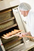 picture of baguette  - Fresh baguettes coming out of the oven - JPG