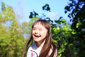 pic of playgroup  - Portrait of beautiful young girl in the park - JPG