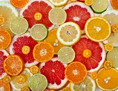 stock photo of sweetie  - slices assortment citrus top view surface close up - JPG