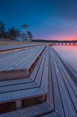 stock photo of long distance  - Beautiful long exposure landscape of lake in Mazury lake district  - JPG