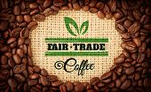 stock photo of oval  - Fair Trade graphic against coffee beans with oval indent for copy space - JPG