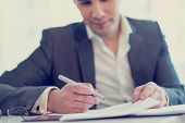 picture of lawyer  - Retro image of young confident lawyer or businessman about to sign a contract or agreement - JPG