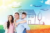pic of piggyback ride  - Happy parents giving piggyback ride to children while looking up against blue sky over green field - JPG