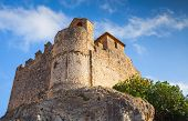 picture of yellow castle  - Medieval stone castle on the rock in Spain - JPG