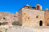 pic of yellow castle  - Medieval stone castle facade main landmark of Calafell town Spain - JPG