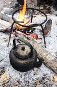 foto of kettles  - Old Kettle Boiling Water For Coffee Or Tea In Countryside In Thailand