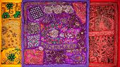 picture of flea  - Colorful ethnic Rajasthan cushion covers on flea market in India - JPG