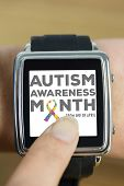 pic of autism  - Businesswoman with smart watch on wrist against autism awareness month - JPG