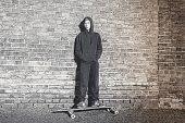 foto of hoodie  - black and white shoot of a teenage boy with hoodie standing on a long board - JPG