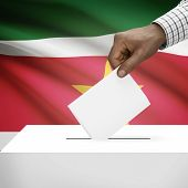 pic of suriname  - Ballot box with flag on background  - JPG
