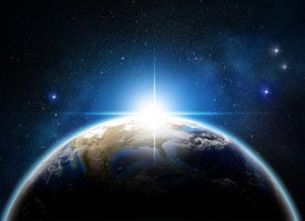 stock photo of outer  - sunrise over the earth in outer space - JPG