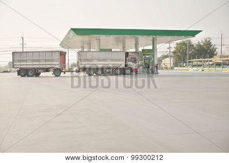 Tolled truck filling diesel fuel from local brand gas station. This tolling style truck is now illeg