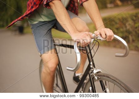 Close up shot of Hipster on bike at the city
