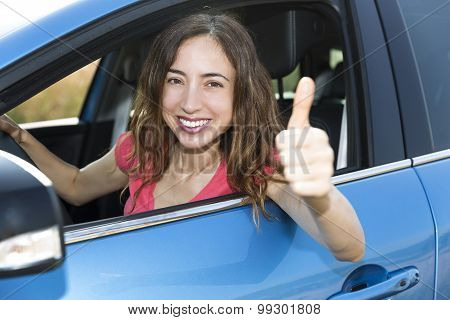 Female Driver Thumbs Up