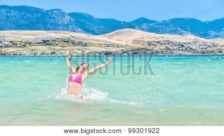 Woman Is Jumping Out Of Water Celebrating Healthy Lifestyle