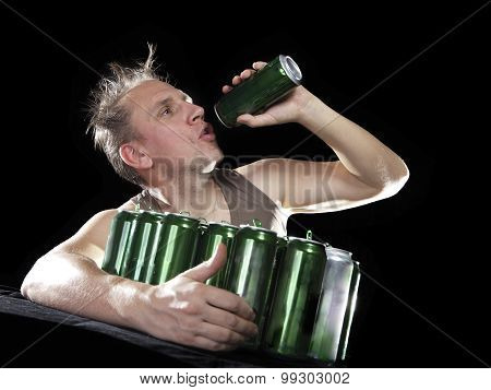 Hangover. The man wants to drink the last drink of beer from an empty can