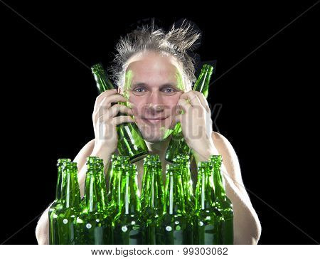 The happy tipsy man near empty beer bottles