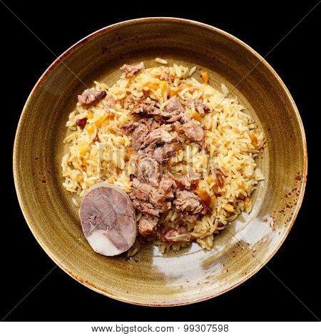 Pilaf, traditional dish of the Middle East, isolated over black