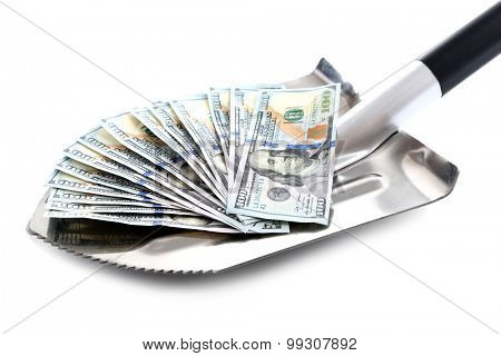 Shovel lifts dollar bills on white background