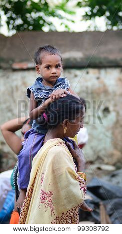 Indian Woman With Her Son On Street