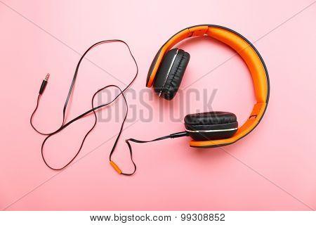 Headphones on pink background