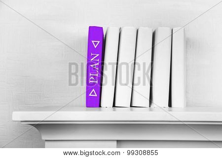 Stack of books on shelf close-up