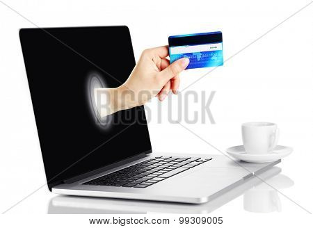Laptop with credit card in hand isolated on white