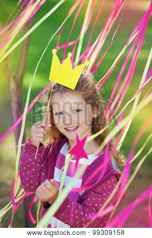 little girl with a paper crown