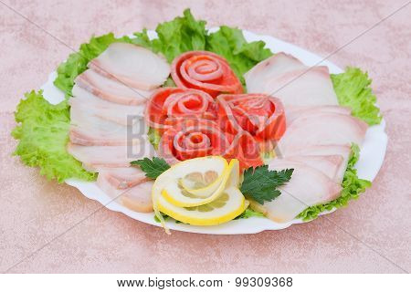 Meat and greens in a plate