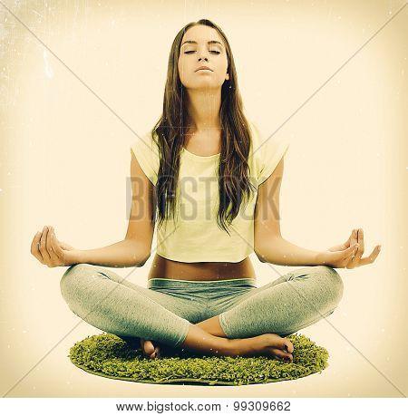 Young beautiful fitness girl doing yoga exercise