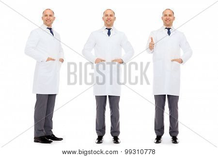 medicine, science, profession and health care concept - happy doctors with stethoscope showing thumbs up