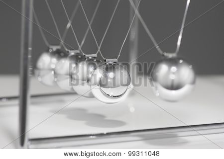 Newtons Cradle - iconic business symbol