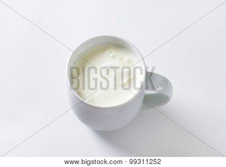mug of milk kefir on white background